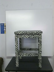Designer Fabric-Covered Tables and Bookcases