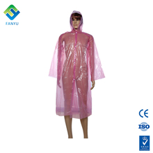 womens pink ladies in plastic raincoats