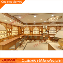 bright jewelry shop interior design wooden gold cabinet jewellery display