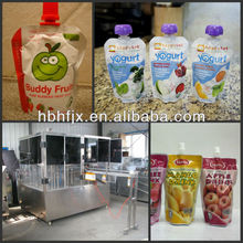 UK Cow & Gate Rice Pudding in spouted pouch filling and capping packing machine