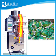 automatic puffed food weighting and packing machine / peanuts packets filling and sealing machine