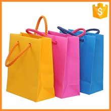Xiamen Printed Color Kraft Vogue Shopping Paper Bags Manufacturer