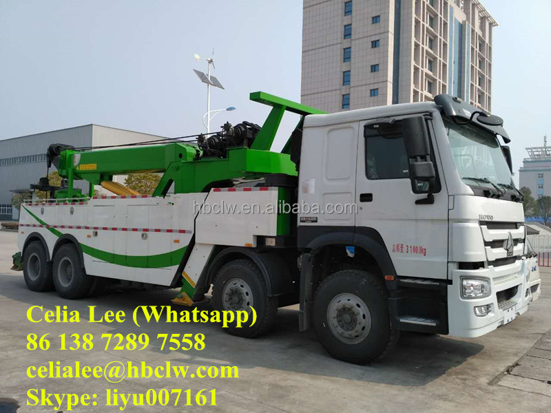 Sino Howo 8x4 wrecker truck 360 degree fully rotation crane towing and lift separate wrecker 50 ton wrecker truck