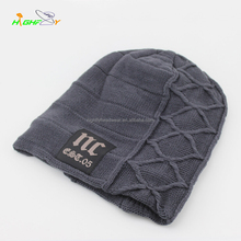 Luxury plush knit beanie hat with woven label