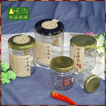 Stock low moq round food packaging glass jars wholesale for jam honey use