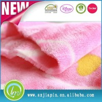 Pink color flannel fleece 100% polyester soft fluffy blanket fabric