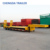 Heavy equipment tri axles 60 ton low bed trailer with container lock