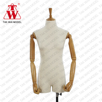 Fashionable nude lady with wooden arm mannequin