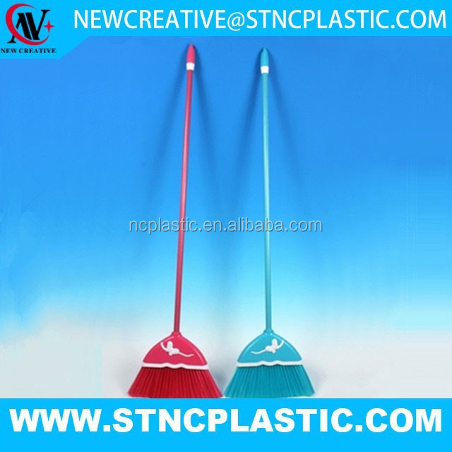 different color small plastic dustpan with broom and handle