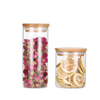 wholesales customized different size of cylinder shape borosilicate glass storage jar for food with bamboo lid of food grade