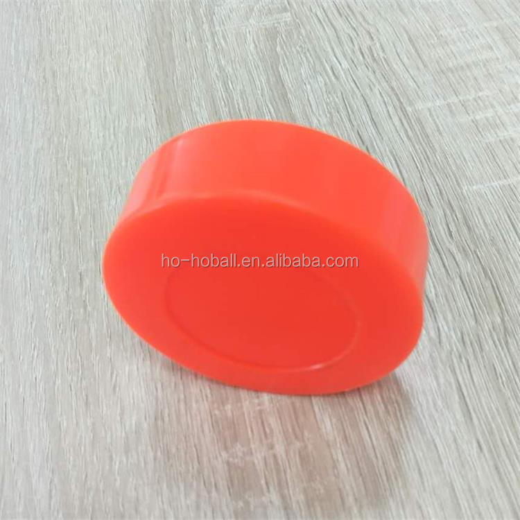 High density molded PVC street roller hockey puck