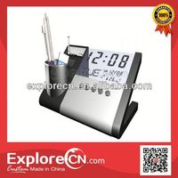 Electronic calendar with radio and pen holder function