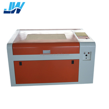 Jingwei 4060 5070 small cutter 50w 60w CO2 laser engraving machine price