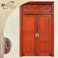 Oversized narra wood entry door design in UAE
