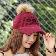 Female new alphabet ball wool knitted hat warm autumn raccoon fur ball peaked women baseball cap