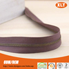Stylish long chain zipper high quality metal zipper in roll with decorative tape
