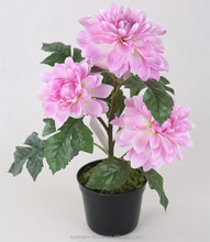 Artificial silk pink dahlia flower in plastic pot