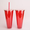Plastic tumbler with straw paper insert