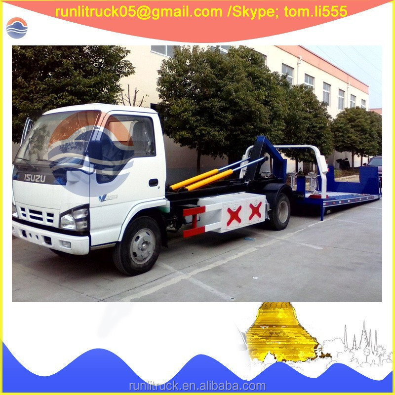 China tow truck factory direct sale for QL10909KARY Japanese brand ELF 4*2 5 ton flatbed recovery vehicle sale in peru