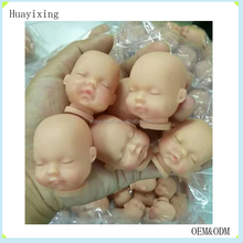 lifelike vinyl doll heads and hands