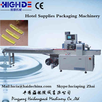 Hot selling hotel amenities packing and packaging machine price, towel packaging machine