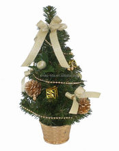 Peal Wrapped Small Plastic Christmas tree with golden items