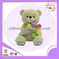 plush bear doll with flower
