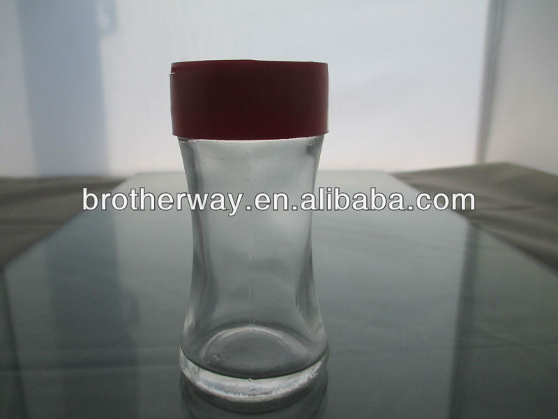 clear glass spice jar with plastic pepper shaker