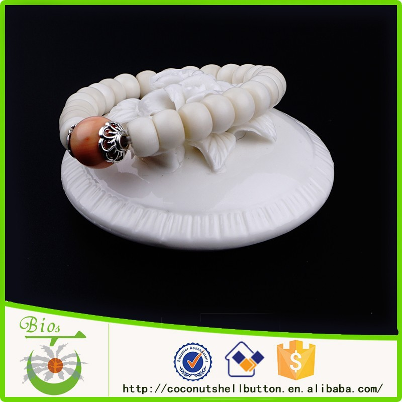 Shinny tangerine color 14.5cm round shape high quality pearl shell bespoke children clothing bracelet jewelry