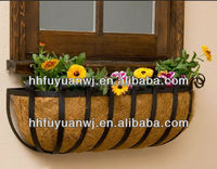 metal hanging basket with hanging coconut fabric covering