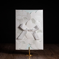 white ribbon decorated arabic greeting wedding invitation card CW5176