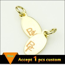 Wholesale 11x6.5mm gold plating laser engraved logo custom metal jewelry tags