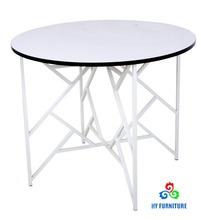 Unique round wooden dining table with metal frame for home used