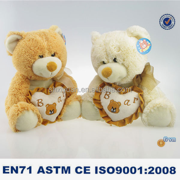 Animated plush toys teddy bear with heart shaped pillow