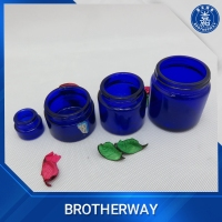 Cobalt blue skin care cosmetic glass cream jar with acrylic cap