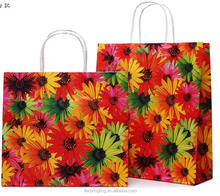 LE 150g China low price sunflower design gift paper bag with handles