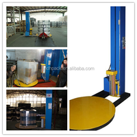 Shrink wrapping machine/pallet shrink wrapping machine
