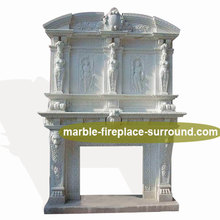 detail carving large natural gas fireplace surround