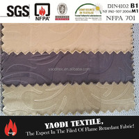 Wholesale 100% polyester flame retardant water proof and fire resistant matt embossed blackout fabric with black yarn