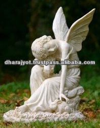 marble angle statue with rabbit