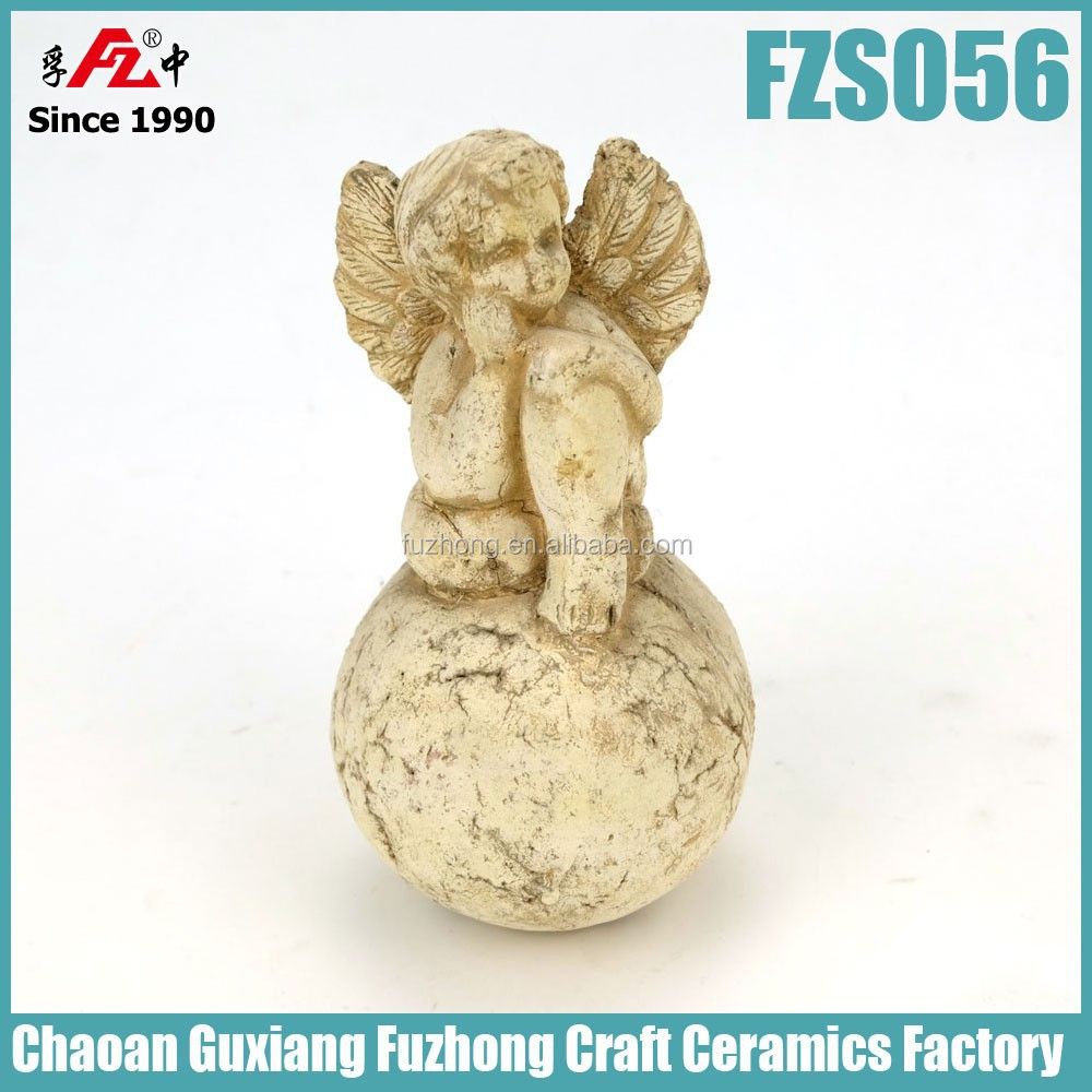 Shabby ceramic angel with ball for garden decoration