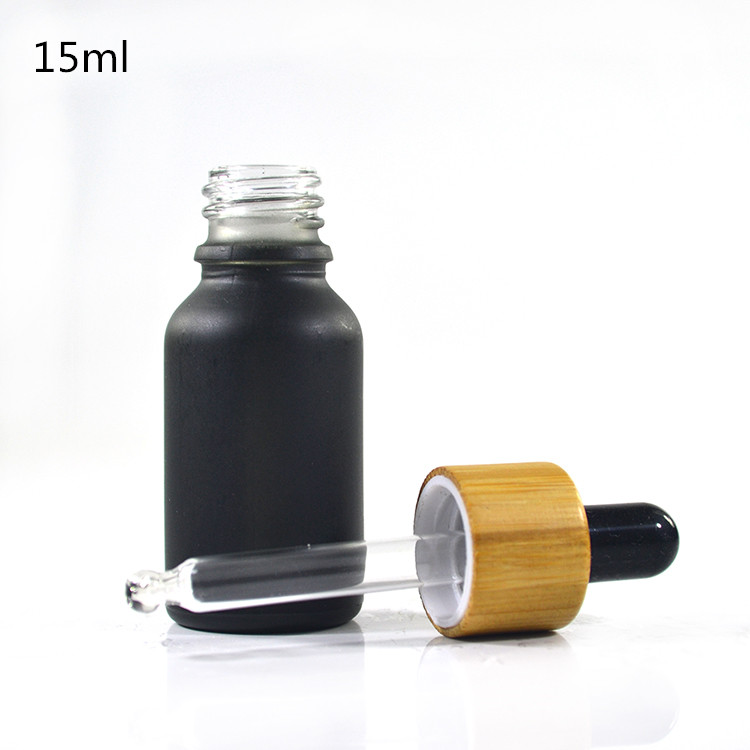 Wholesales 10ml 15ml 30ml 50ml 60ml 100ml smoking oil matte frosted black glass e liquid dropper bottle with bamboo wooden cap