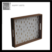 Wooden tray in golden leaves for food serving