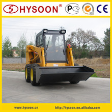 Skid steer loader with blade, various attachments, small bulldozer