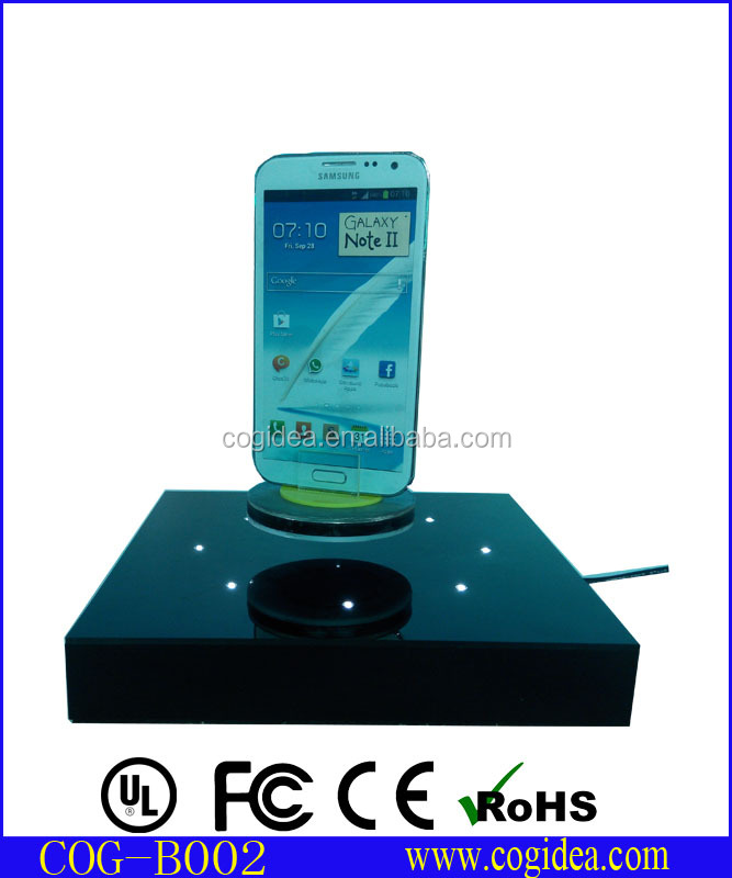 Magnetic levitating turning stand , acrylic cell phone display holders for note 2