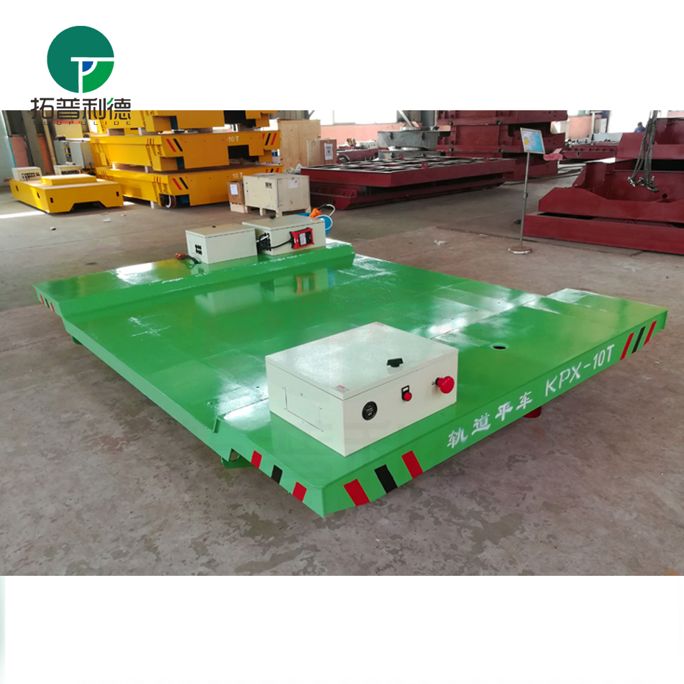 Flexible product transfer cement plant vehicle with lifting table