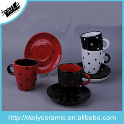 dot design and colorful cup and saucer
