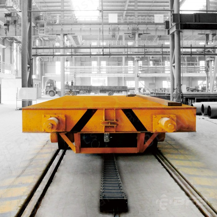 Electric material handling transfer cart rail mounted vehicles