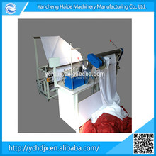 Knitted fabric folding and rolling machines