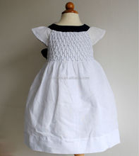 Hot sales sleeveless cotton linen navy bow smocked girl's dress